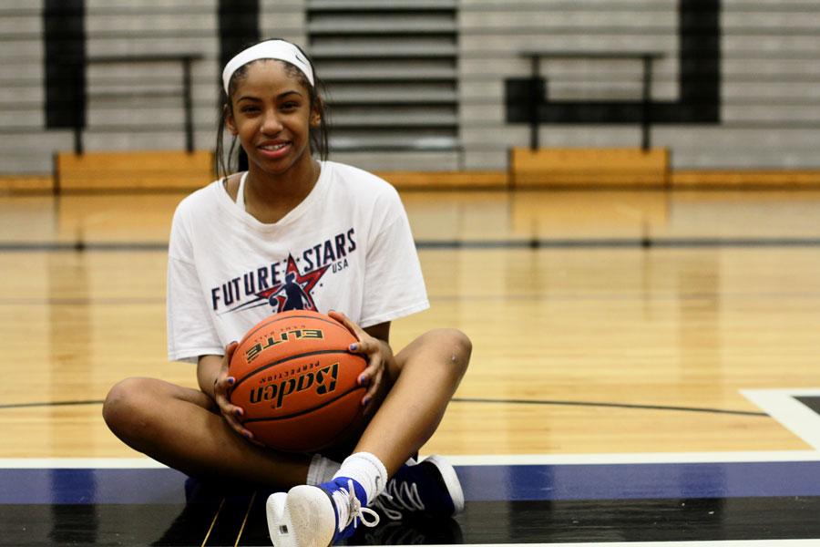 Freshman+Cammie+McKinney+poses+on+the+super+H+in+the+gym.+McKinney+is+the+only+freshman+on+the+varsity+girls+basketball+team.+