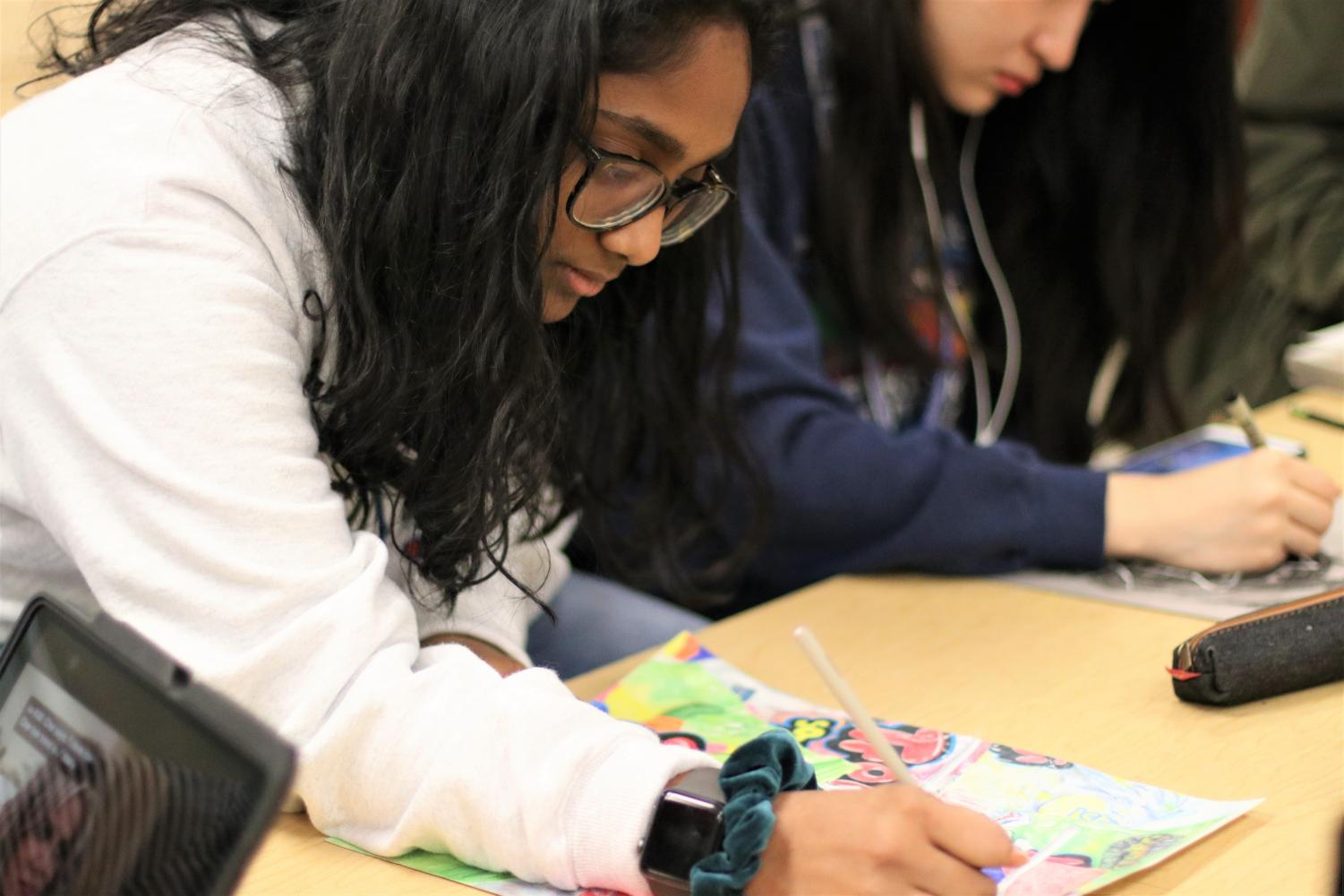 Junior Shruti Ada works on a recent art project in Art 4.