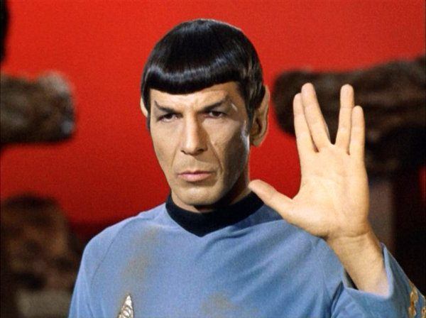 """Leonard Nimoy as Mr. Spock shows the Vulcan salute, usually accompanied with the words, """"Live long and prosper."""" (Photo by CBS via Getty Images)"""
