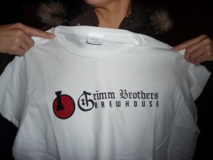 A friend displays a Grimm Brothers Brewhouse t-shirt.  Photo by H.M. Kerr-Schlaefer