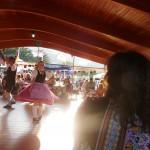 girl dancing with shadows at Biergarten Festival