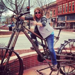 Heidi riding big bike in downtown Grand Junction Colorado HeidiTown