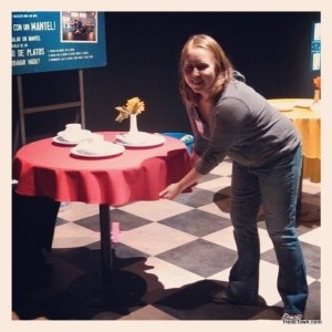 Heidi trying to pull the table cloth out without disturbing the dishes at the Mythbusters exhibit at the Denver Museum of Nature and Science. HeidiTown.com