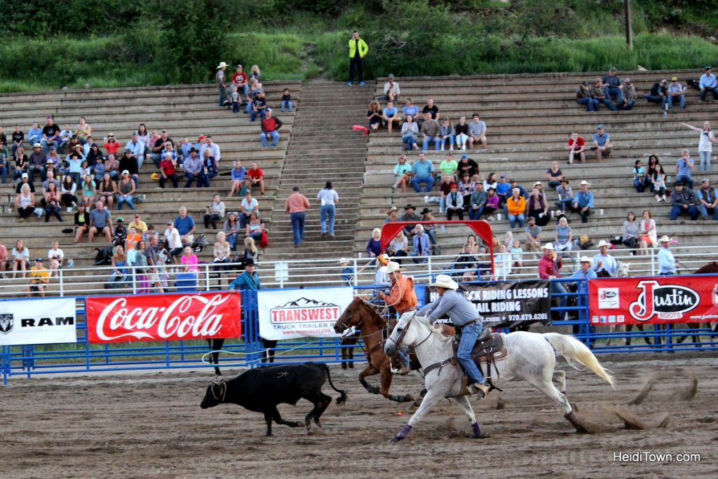 Kickin' it at the Pro Rodeo in Steamboat Springs. calf roping. HeidiTown.com