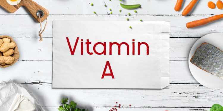 Vitamin A rich foods around a piece of paper that says Vitamin A.