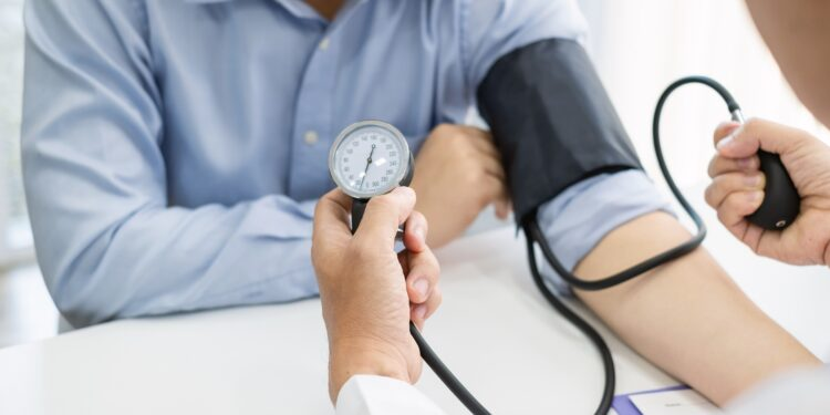 Doctor measures a patient's blood pressure