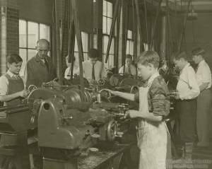 ALT:Students being instructed by teacher Wesley Budde in the Taylor Allderdice High School Machine Shop class, 1941. Pittsburgh Public School Photographs, MSP 117, Detre Library & Archives, Heinz History Center