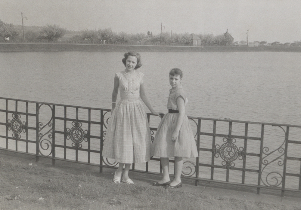 Sisters Barbara and Diane pose at the Highland Park reservoir, 1956. Taylor Family Collection, Detre Library & Archives at the History Center.