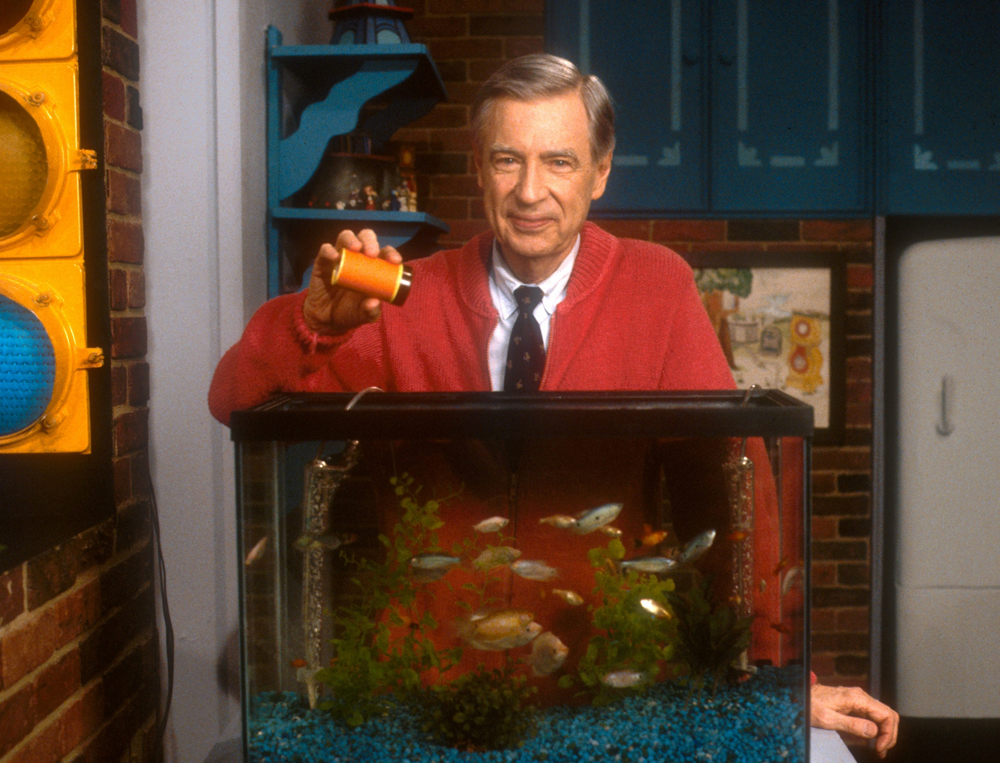 """Mister Rogers feeding the fish during """"Mister Rogers' Neighborhood."""" Photo courtesy of The Fred Rogers Company."""