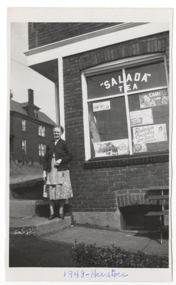 Mary outside her corner store at 22 Overland Street, Duquesne, 1948. From the Rajcan family collection, Detre Library & Archives at the History Center.