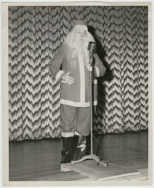 George Heid plays Santa on stage. Photo courtesy of Jim Heid.