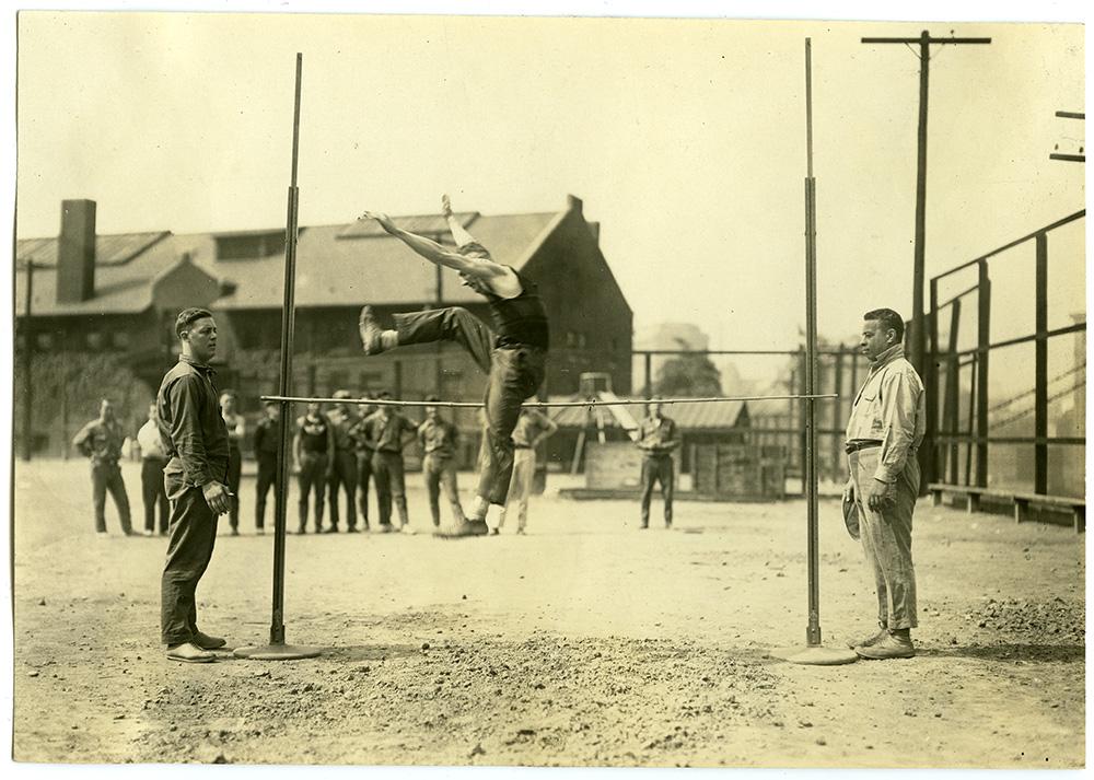 Dorsey supervises the high jump practice at Washington Park, 1922.