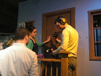 """History Center registrar Nicole Lauletta assists an """"A Beautiful Day in the Neighborhood"""" crew member recording the sound of a door opening and closing on The Great Oak Tree, residence of Henrietta Pussycat and X the Owl."""