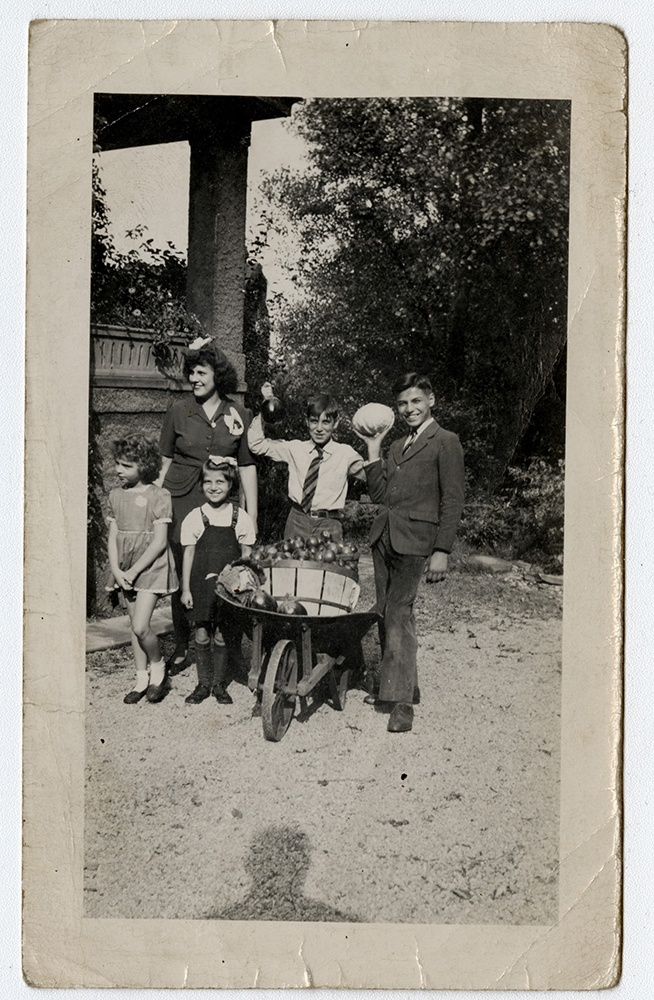The Caliguiri Family poses with produce from their victory garden, 1940s.