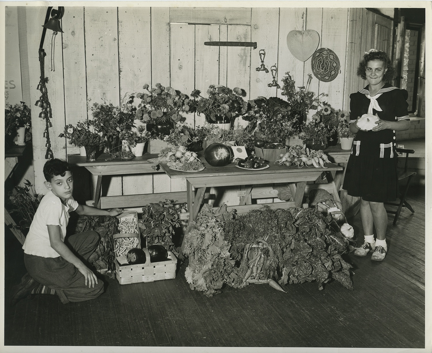 Pittsburgh Public School students pose with the output from one of their gardens, possibly a victory garden, 1940s.