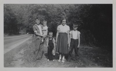 Paul posing with his siblings in the summer of 1954 alongside a road. Left to right: Paul, Alan, Glen, Mary Ellen, and George Dick. Holly and Paul Dick Family Papers and Photographs, MSS 1177, Detre Library & Archives at the History Center.