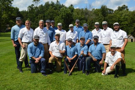 The Mountain Stars and Frosty Sons of Thunder teams at Meadowcroft. Adam Johnson is in the back row on the far left, and Jenette is in the front row between the bats.
