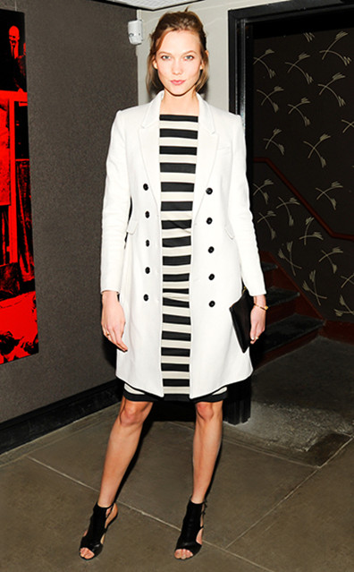 Parisian Style; Trench Coat Outfit Ideas; Karlie Kloss at J.Crew party, New York – March 26 2014: wearing jcrew white coat, striped dress, cutout booties, gold accessories.