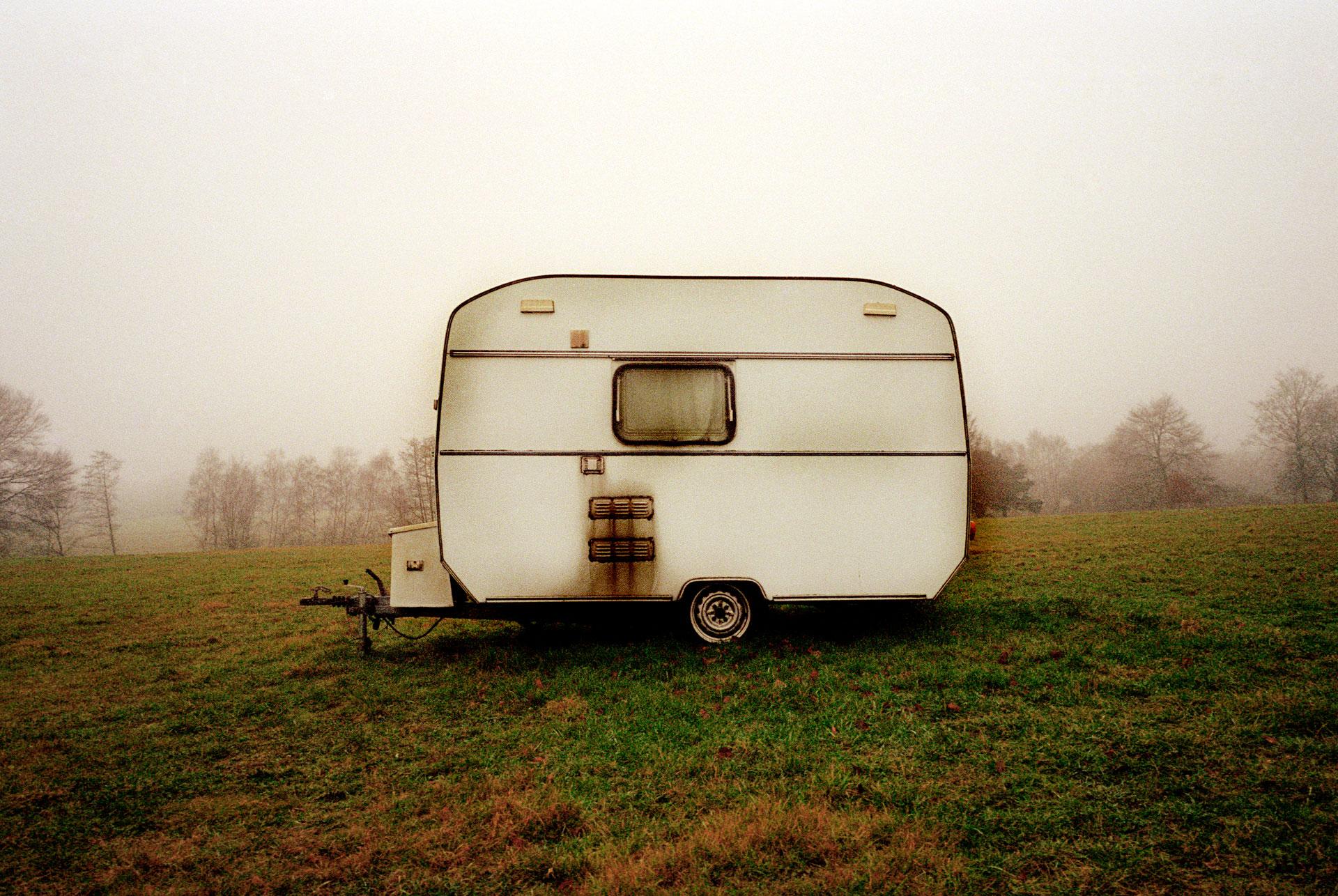 Jason Florio photography - color image of a lone vintage caravan in a dawn field, Surrey, England