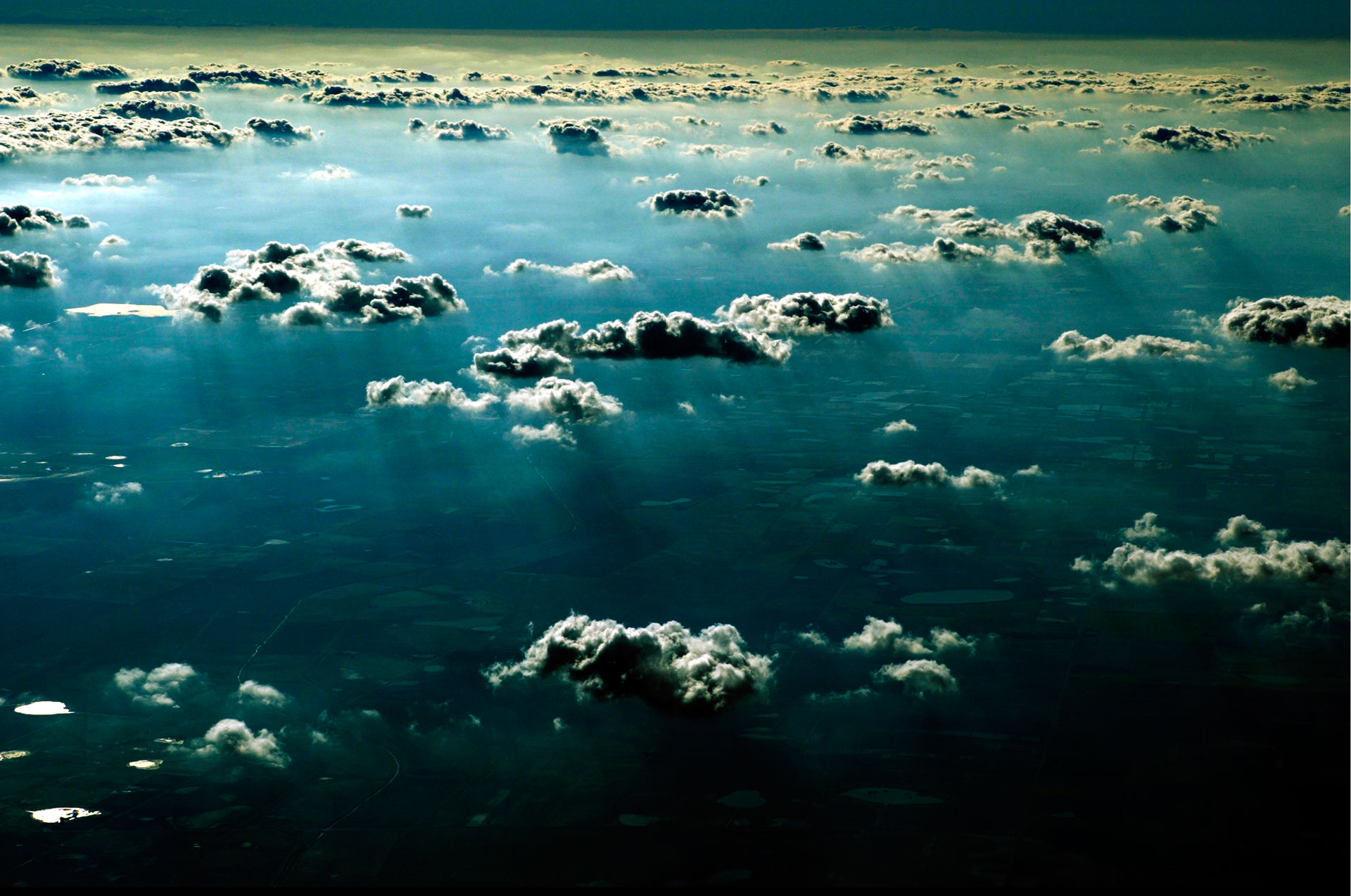 Jason Florio photography prints -color image of the clouds, blue sky, photographed from a plane, flying over Texas