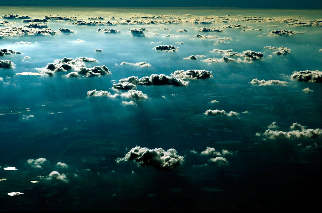 Jason Florio photography - Image of above blue sky and clouds, above Texas - taken from the window of a plane
