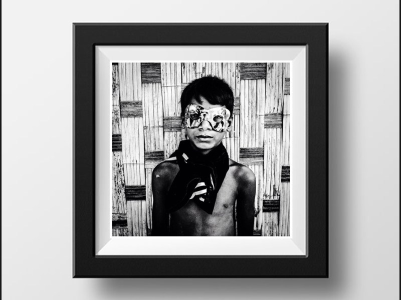 Black and white - boy wearing mardi gras mask 'Boy in Mask, Burma' © Jason Florio. Photography prints