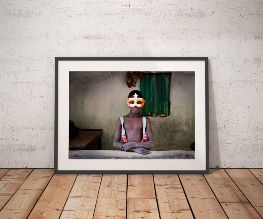 Photography Prints Gallery - River Gambia Expedition:  'Boy in the Mask' 1 © Jason Florio-color portrait of young Gambian wearing a mardi gras mask