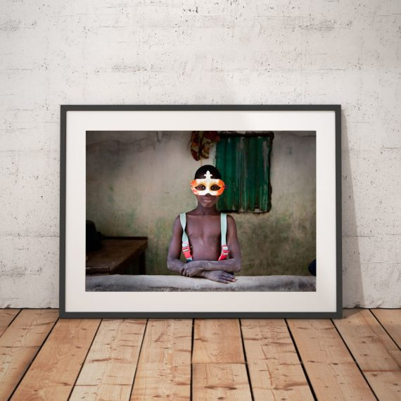 Photography Prints Gallery 'Boy in the Mask' 1 © Jason Florio-color portrait of young Gambian wearing a mardi gras mask