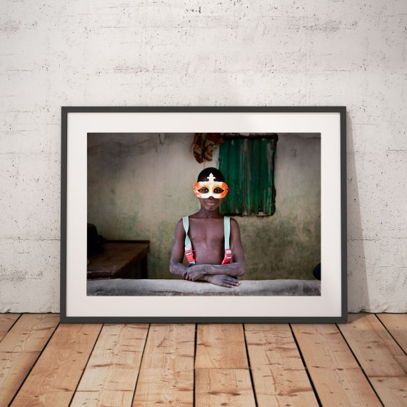 'Boy in the Mask' 1 © Jason Florio-color portrait of young Gambian wearing a mardi gras mask