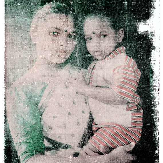 #2 - ALSO IN INDIA © OSKAR LANDI. Color. Polaroid- portrait young Indian woman holds her baby boy