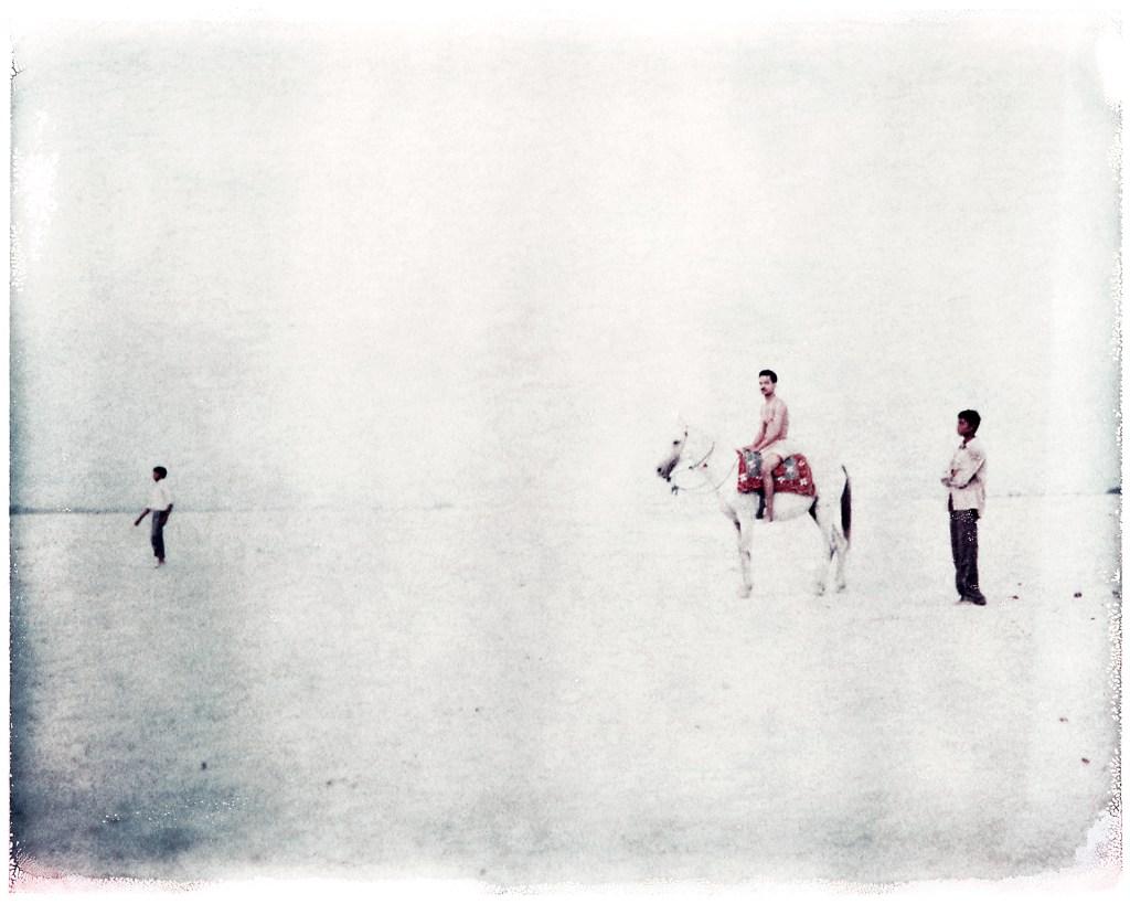 Oskar Landi Photography - image of 3 men, one on a horse, India