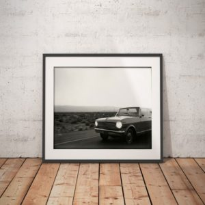 'Palm Springs' Route 66, USA ©Chris Bartlett. Black and white framed print -vintage convertible car, driving through the desert