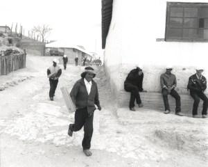 KWIRA (TARAHUMARA), MEXICO #152 © Oskar Landi. Black and white framed print, village scene, men walking and sitting around