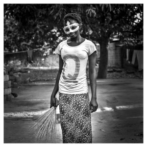 'Mask Girl' The Gambia © Jason Florio. BW Young girl wearing a mardi gras mask, West Africa