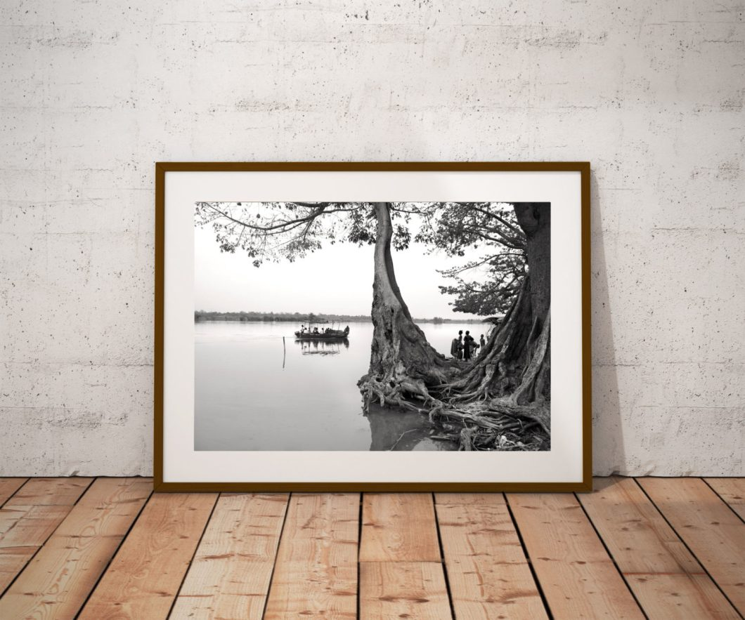 Photography Print Gallery - River Gambia Expedition:  Kuntaur Wharf, River Gambia © Jason Florio - Black and white print of women waiting by a tree for a boat