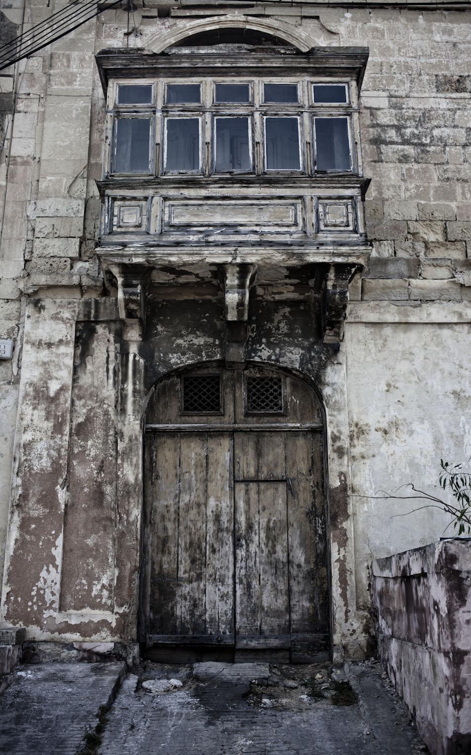 Wabi sabi Doors and facades, with traditional Maltese balcony, Msida, Malta ©Helen Jones-Florio