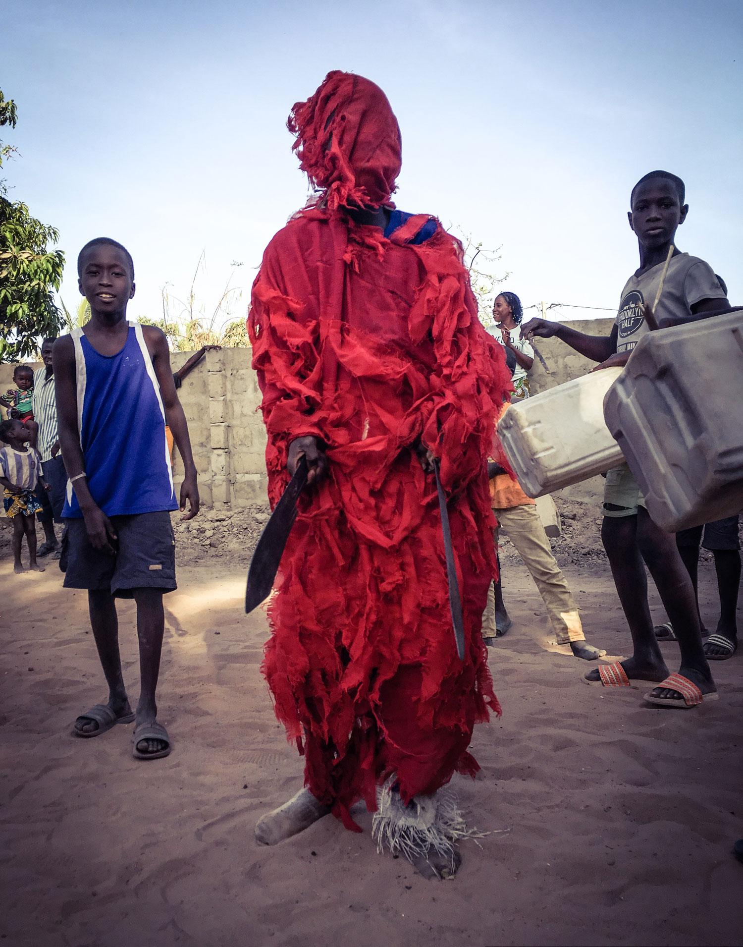 Kankurang with machetes - Traditional Masquerade, The Gambia © Helen Jones-Florio