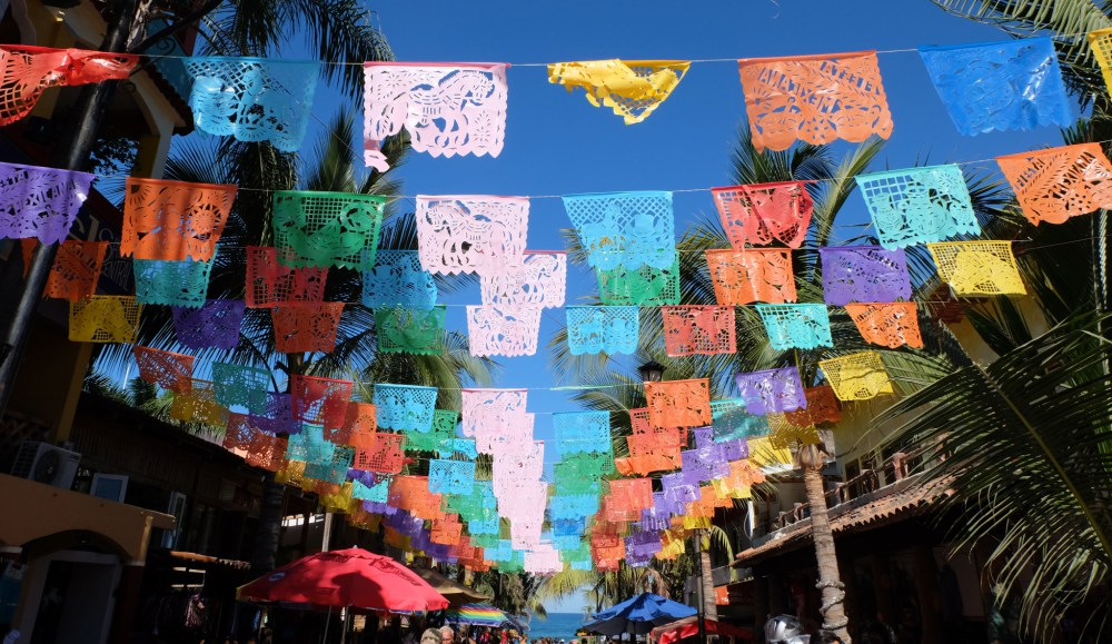 Colourful flags on the main street in Sayulita
