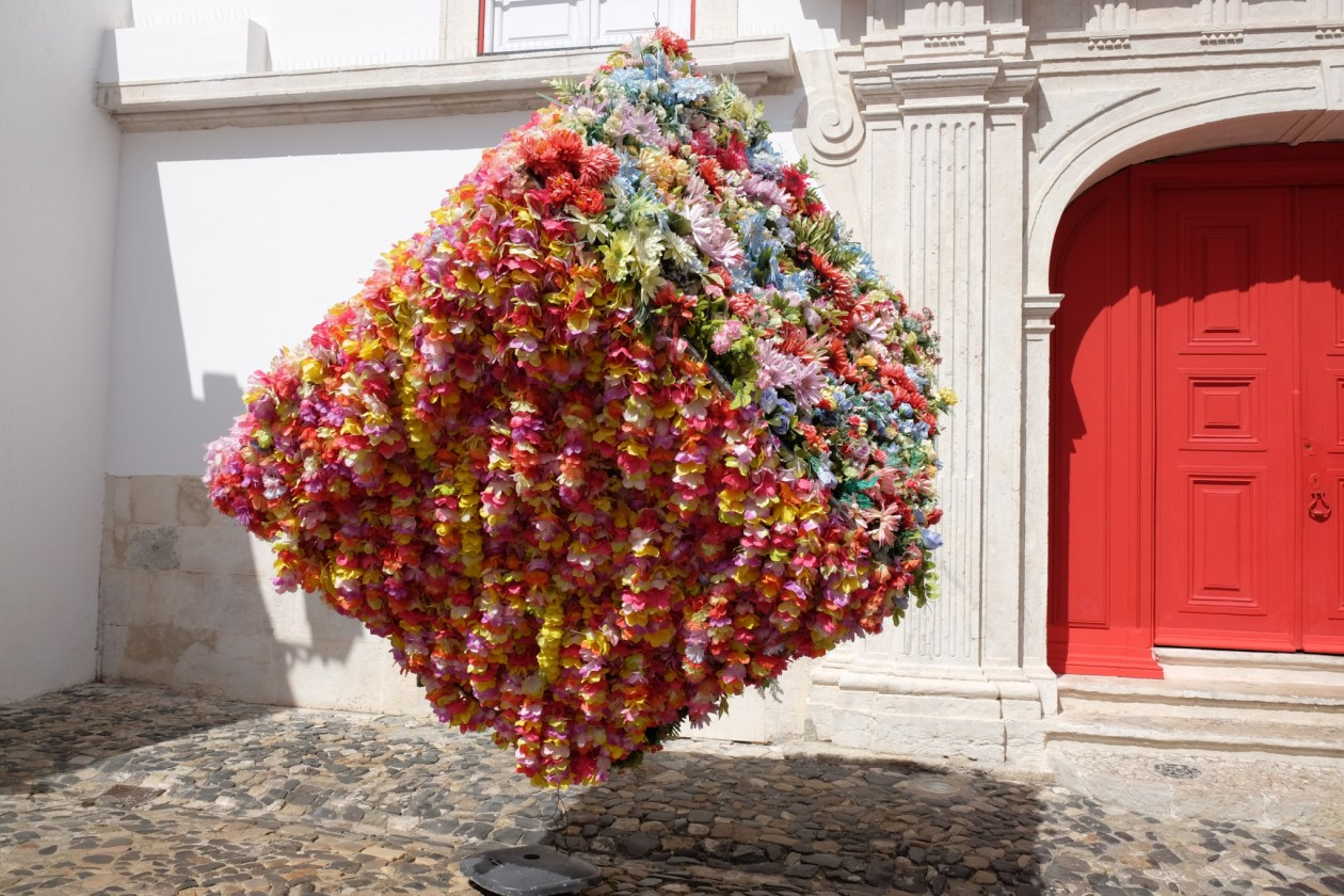 A gorgeous floral art installation in a courtyard near the Castle
