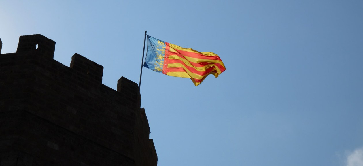 The Valencian flag flying from the 14th century Torres de Serranos