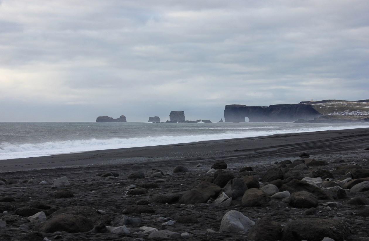Looking back along the beach towards Dyrhólaey Arch