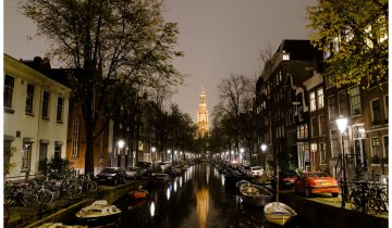 One of Amsterdam's most iconic sights: the distinctive church tower of Zuiderkerk, as seen from Groenburgwal canal.