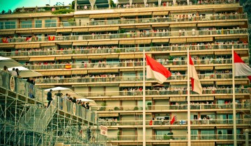 Spectators watch the 2007 Formula 1 Monaco Grand Prix from the terraces of high-rise residential towers.