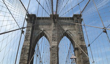 A photo of the Brooklyn Bridge's iconic central tower.
