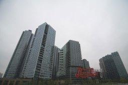 High-rises dwarf the Pepsi-Cola sign