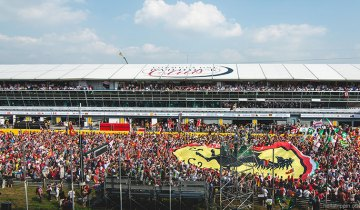 The fans gather on track at the post-race podium ceremony for the 2014 Formula One Italian Grand Prix at Monza.
