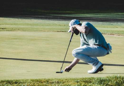 Golf player being on the green for an easy putt after following his game plan - game improvement directly visible on the result