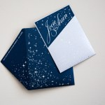 navy with stars and silver pocket custom lasercut monogram, printed hindu wedding program with elephants, laser cut table numbers | AZURE