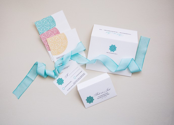 tiered modern letterpress design with printed envelopes and RSVP card