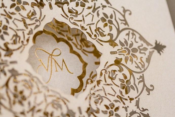 lasercut invitation with monogram in gold